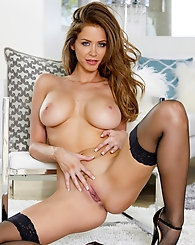 Emily Addison inserts her fingers against her aroused clit